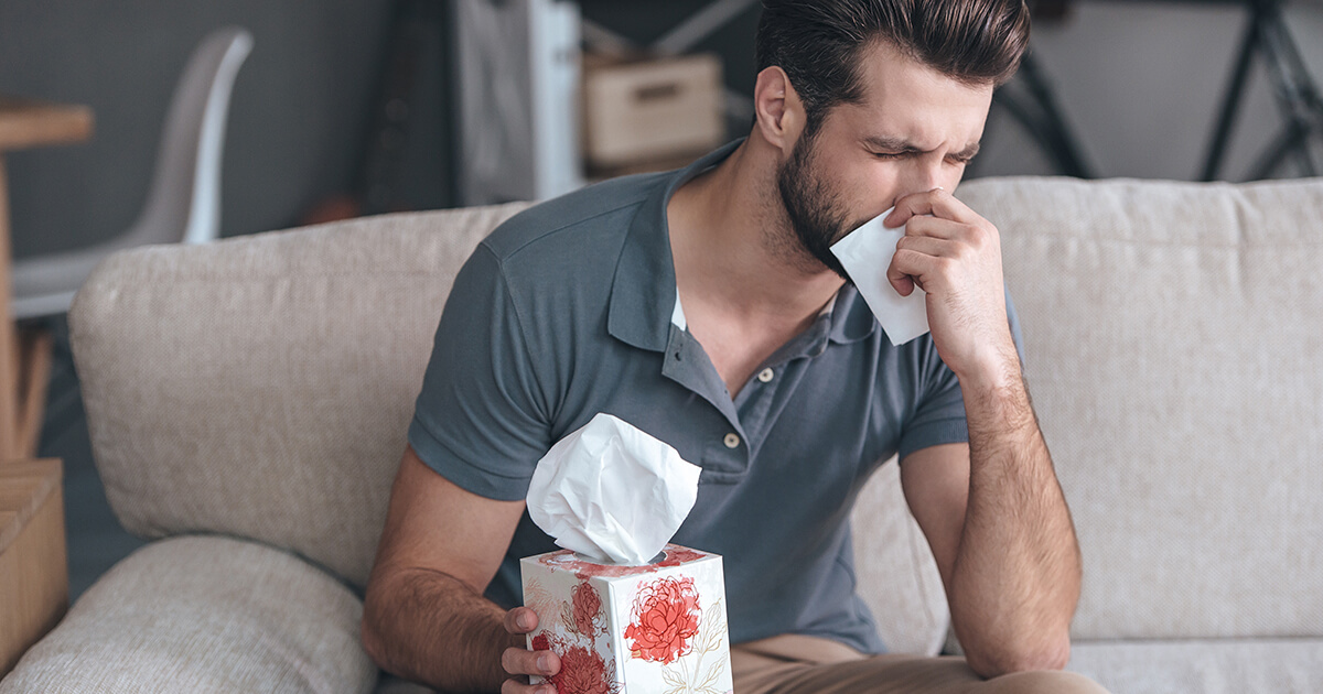 Man Suffering From Indoor Allergies | A-Z Air Duct